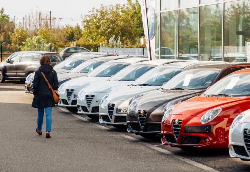 Shopping new car woman choosing car in a row